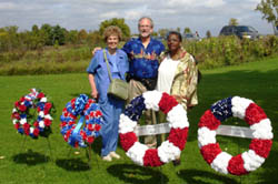 Pictured with some of the wreaths before ceremony Michael's Mom, Michael Boyd, CA Society & Joyce Armstrong