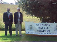 Past Chapter President Rick Saunders and Chapter President Duane Booth pose with the Chapter's banner.