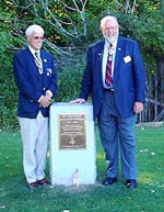 Chapter President Duane Booth & Secretary General McCarl pause for a camera shot at the Chapter's monument.