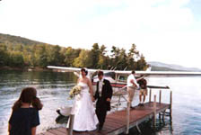 Jonathan and Ruth arrive at their reception in a seaplane.