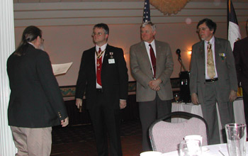 Past Chapter President Rick Saunders installs Chapter Officers: Richard H. Fullam, President; Primitivo Africa, 1st Vice-President (pictured is stand-in Peter Fullam), Dennis F. Marr, Genealogist (photo courtesy of Dianne Fullam)