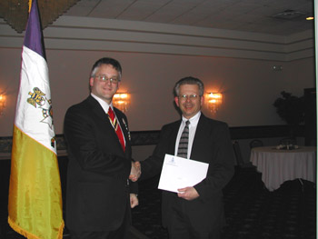 President Rich Fullam congratulates and welcomes Bob Brownell to the Chapter (photo courtesy of Dianne Fullam)
