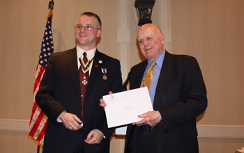 Richard C. Saunders, III* and President Fullam *Dick Saunders accepted for his grandson Richie who is the son of Rick and Lyn Saunders - Photo: Rick Saunders