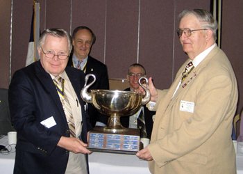 Chapter President and Registrar Thomas L. Dunne (l) receives the Addams Cup from Society Registrar William J. Woodworth