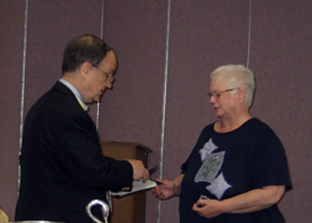 Kitty receives the Daughters of Liberty Award from President Sage