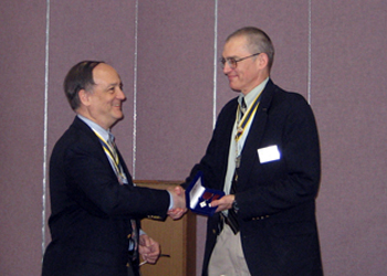 President Sage presents Peter with the Distinguished Service Award