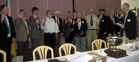 Past President Col. Peter K. Goebel installs newly elected officers and Managers
