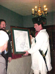 Rick presents speaker Karl Crannel with Revolutionary War era map of Saratoga.