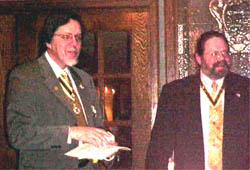 Past President Dennis F. Marr receives a gift from President Saunders for helping Rick during his term.