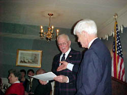 President Booth presents new member Joseph Insull Whittlesey with his Membership Certificate.