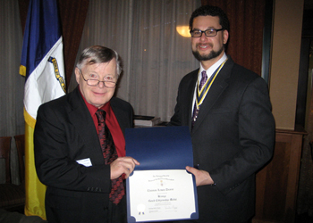 Tom receives Bronze Good Citizenship Award from President Africa