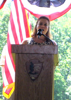 Vocalist Danielle McMullen sings the Star Spangled Banner