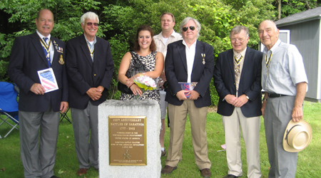SARs take a photo op with Danielle in front of the monument that we rededicated in 2002. (L-r)Tim Mabee, Duane Booth, Danielle McMullen, Tim Condon, Bill Nottingham, Tom Dunne and John Sheaff