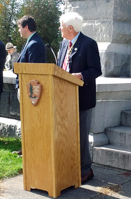 (L-r) Village of Victory Mayor James M. Sullivan and Duane Booth watch the musket salute - Photo: R. Harry Booth