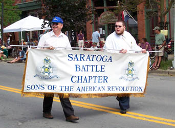 The author, Dennis Booth (L) and Ray LeMay carry the Chapter Banner