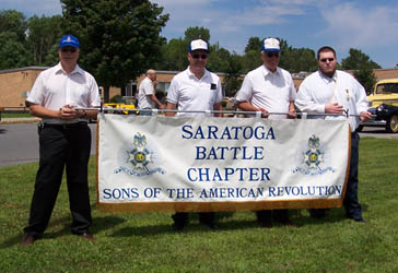 Preparing the Chapter banner - (L-R) Dennis Booth, George Ballard, Duane Booth, Ray LeMay