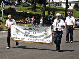 R. Harry Booth and Duane Booth with banner and Saratoga Battle Chapter President Rich Fullam.