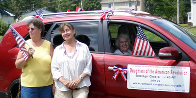 (l to r) Cheryl Doyle, Andrea Hyde, and (inside) Dorothy Mitchell, Saratoga Chapter NSDAR with their parade vehicle - Photo by Eleanor Morris