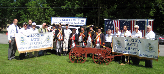 Members of Walloomsac and Saratoga Battle Chapters, SAR, pose with members of the 2nd Continental Artillery - (L-r) Tim Mabee, Pat Festa, Doug Gallant, John Sheaff, Dennis Booth, Jim Hilton, Al Bartlett, Tim Butler, Bret Trufant, Andrew Companion, Pete Hormel, Mike Companion, Brad Allen, Tom Dunne, Harry Booth, Tivo Africa, Duane Booth, Pat Reilly.  The 3 pounder, which was built by Mike Companion, is named 'Cricket'