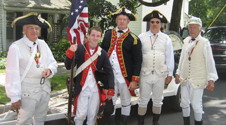 Re-enactors from the 2nd Continental Artillery - (L-R) Al Bartlett, Andrew and Mike Companion, Bret Trufant and Jim Hilton in the parade staging area