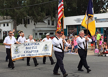 Chapter members Jay Lacy and Pat Reilly in the lead, Primitivo Africa, Tom Dunne and Pat Festa with the banner and Duane Booth, Harry Booth and Douglas Gallant bring up the rear