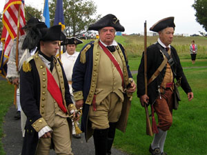General Horatio Gates (center) leads his troops