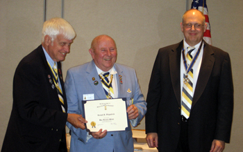 Capital VP Joseph Fitzpatrick receiving the War Service Medal from ESS President Booth (L) and SBC President Gallant (R)