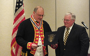 President Galant presenting the Military Service award to 1st Vice President Patrick Reilly