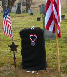 New gravestone before unveiling with a replica of the Badge of Military Merit - Photo by George Ballard